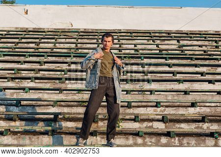 Tall Handsome Man On The Crushed Tribune Of The Old Stadium