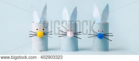 Set Of Paper Bunny Rabbit For Happy Easter Seasonal Party. Easy Craft For Kids On Blue Background, S