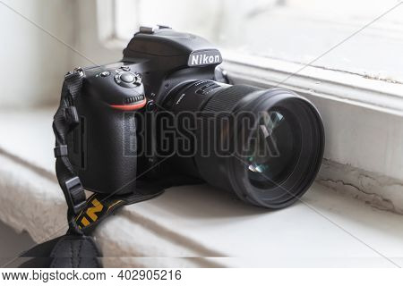 December 2020, Minsk, Belarus - Nikon Dslr Camera With Sigma Lens On The Windowsill
