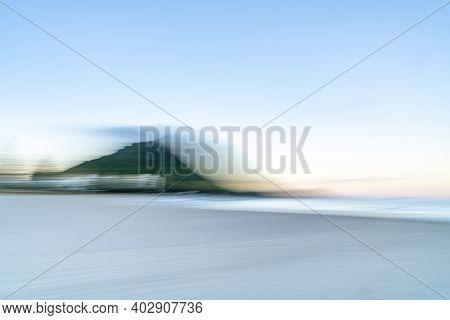 Mount Maunganui Landmark Abstract Using Intentional Camera Movement Of Coastal Scene.