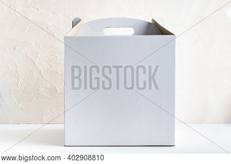 White Cardboard Box For Packing Cakes On White Background. Copy Space.