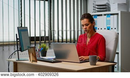 Businesswoman Working At Laptop And Computer In Same Time. Entrepreneur Sitting In Modern Profession