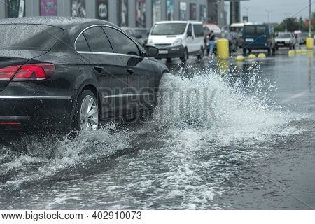 Driving Car On Flooded Road During Flood Caused By Torrential Rains. Cars Float On Water, Flooding S