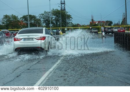 Odessa, Ukraine - August 9, 2019: Driving Car On Flooded Road During Flood Caused By Torrential Rain