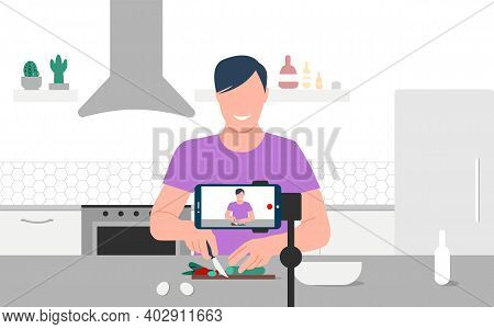 Food Blogger Streaming Live. A Man Records An Online Cooking Video Tutorial On His Phone. A Smiling