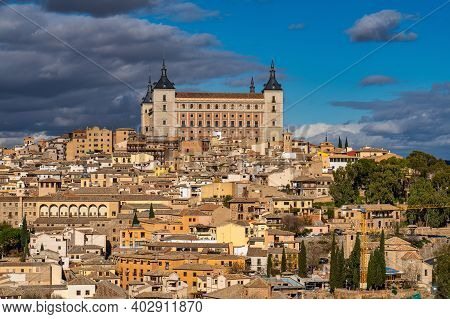 Toledo, Spain. Old City With Its Alcazar, Royal Palace Over The Tagus River Sinuosity. Spain, Europe