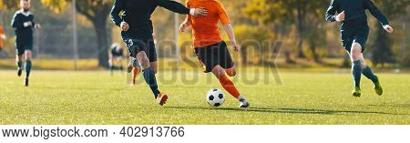 Horizontal Image Of Football Players Running In A Duel On A Tournament Match. Soccer Forward Player