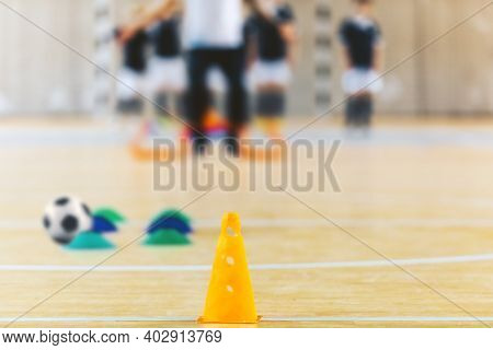 Group Of Kids Training Soccer At Indoor Soccer Field. Indoor Football Training Arena. Coach Training