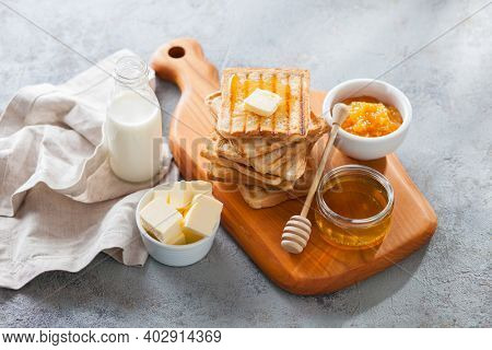 perfect breakfast - toasted bread honey and butter
