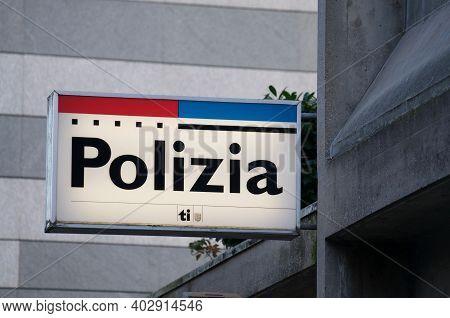Lugano, Ticino, Switzerland - 7th January 2020 : Luminous Cantonal Police (polizia) Station Sign Of