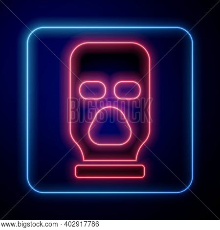 Glowing Neon Balaclava Icon Isolated On Blue Background. A Piece Of Clothing For Winter Sports Or A