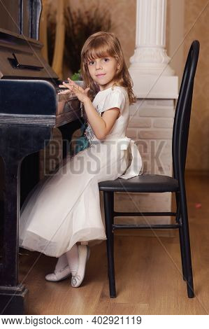 Cute Little Blond Baby Girl Playing Piano Smiling Close Up Portrait