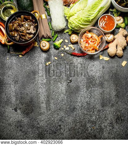 Asian Food. A Variety Of Ingredients For Cooking Asian Food On Rustic Background.