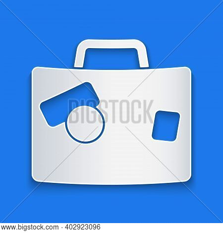 Paper Cut Suitcase For Travel Icon Isolated On Blue Background. Traveling Baggage Sign. Travel Lugga
