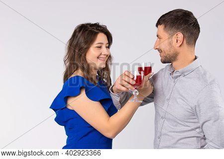 Young Couple Inlove Celebrating St.valentines Day With Glasses Of Wine, Drinking At Bruderschaft.