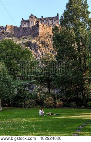 Edinburgh, Great Britain - September 10, 2014: Unidentified People Rest On The Lawn Of The Princes S