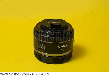 Canon Rf 50mm Lens, Digital Camera, On Yellow Background, For Advertising