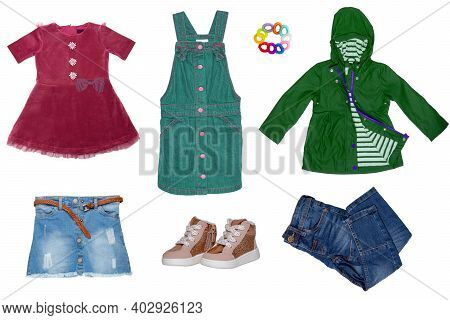 Collage Set Of Little Girl Summer Clothes Isolated On A White Background. The Collection Of Jeans Sk
