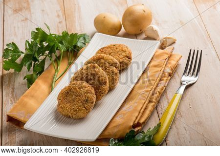 fish croquettes with garlic and potatoes