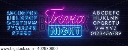 Trivia Night Neon Sign On A Brick Wall.