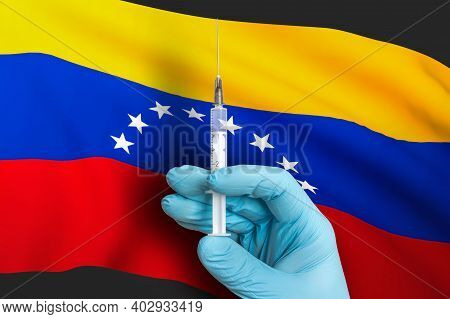 Vaccination In Venezuela. Vaccine To Protect Against Covid-19 On Background Of National Flag.
