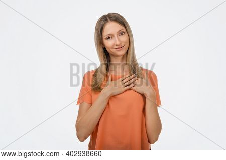 Pleasant Young Blond Woman In Casual Clothes Hold Hands On Heart Cheerfully Thanking For Compliments