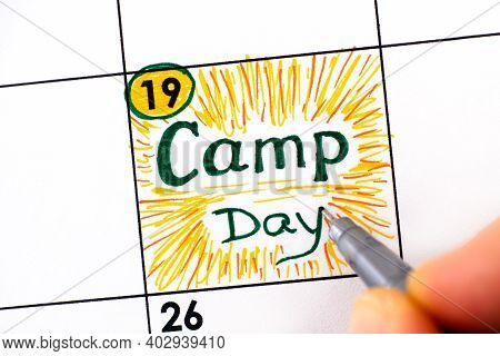 Woman Fingers With Pen Writing Reminder Camp Day In Calendar. November 19