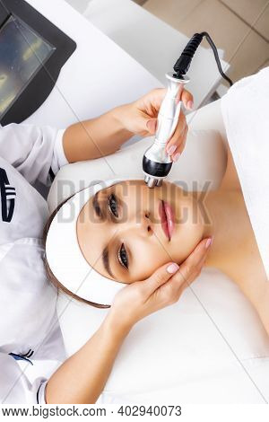 Radio Wave Face Lifting In A Cosmetology Clinic Photo. Skin Treatment. Hardware Cosmetology. Physiot