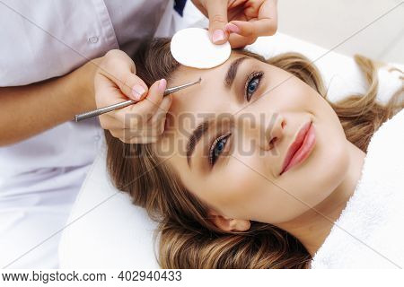 Mechanical Or Manual Face Cleansing. Facial Cleansing By A Beautician. Professional Skin Cleansing.