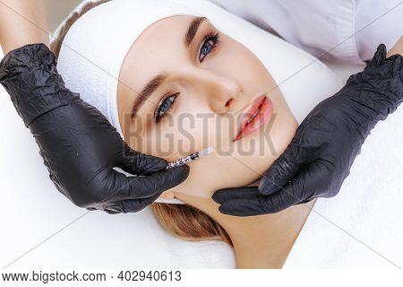 A Woman Undergoing A Facial Bioreinforcement Procedure At A Beautician. Rejuvenation And Treatment O