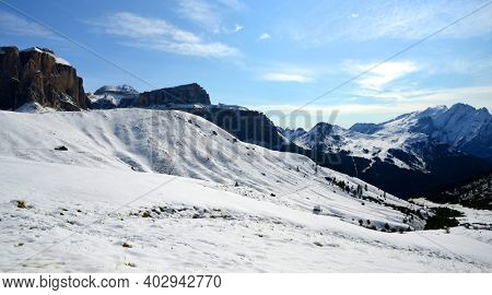 Winter mountain landscape in Dolomites Alps. View on Sella peak and mount Marmolada. South Tyrol, Italy.