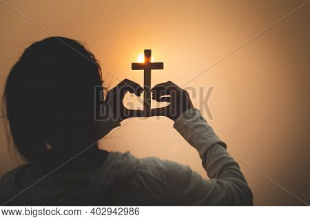 A Woman Holding A Cross Symbolizes The Heart. Backdrop The Sun Christian Religious Concept, The Cruc