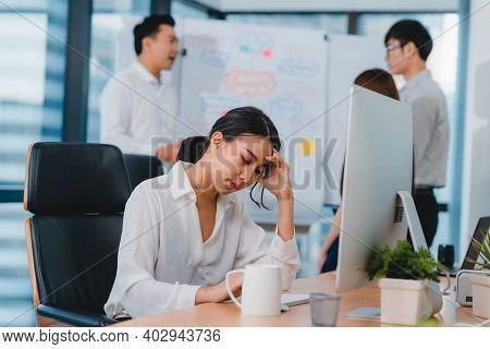 Millennial Young Chinese Businesswoman Working Stress Out With Project Research Problem On Computer