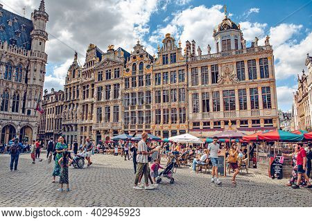 Brussels, Belgium - July 20, 2020: People Walking Through Brussels Famous Grand Place Where The City