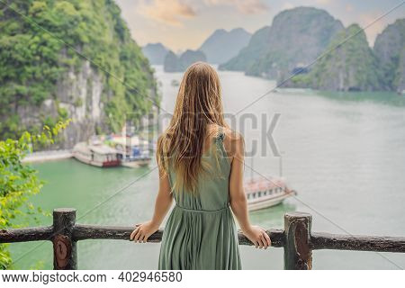 Attractive Woman In A Dress Is Traveling In Halong Bay. Vietnam. Travel To Asia, Happiness Emotion,