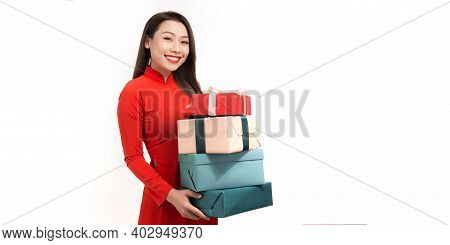 Female's Hands In Red Ao Dai Holding Gift Box On White Background. Christmas, New Year, Valentine's