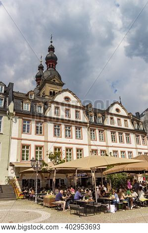 Koblenz, Germany - August 03, 2019: People Enjoying The Sun At A Cafe In Koblenz, Germany
