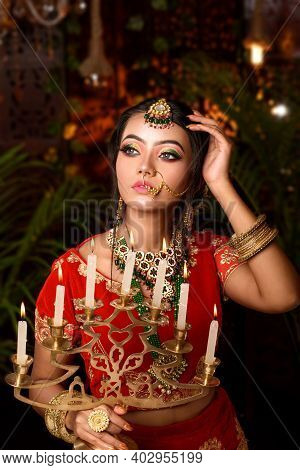 Portrait Of Very Beautiful Young Indian Bride In Luxurious Bridal Costume With Makeup And Heavy Jewe