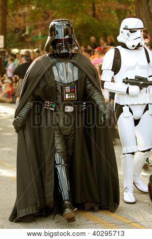 Darth Vader And Stormtrooper Walk In Halloween Parade