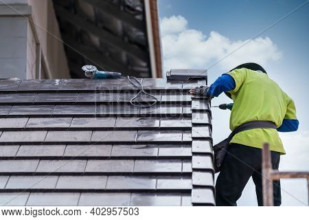 Construction Worker Install Install New Ceramic Tile Roof, Roofing Tools, Electric Drill Used On New