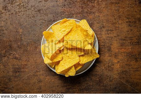 Tortilla chips. Mexican nacho chips on plate. Top view.