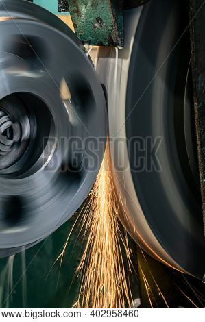Grinding Operations And Metal Processing On A Grinding Machine, Sparks From The Abrasive Fly In Diff