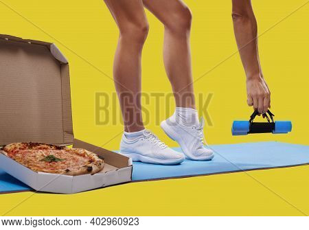 A Box Of Tasty Fresh Pizza, Unrecognizable Fit Woman's Leggs On A Yoga Mat And Hand Holding Dumbbell