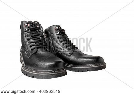 Black Boots Made Of Genuine Leather. Men's Winter Warm Footwear. Isolated Over White Background.