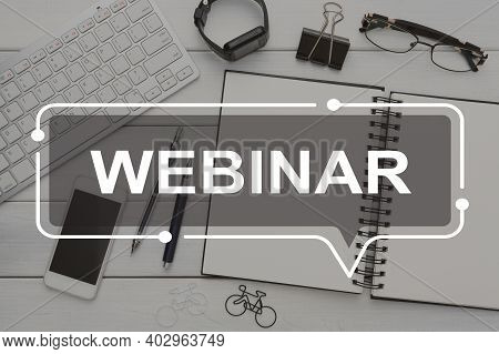 Online Education, Training. White Webinar Inscription In Frame Over Workdesk With Keyboard, Notepad,