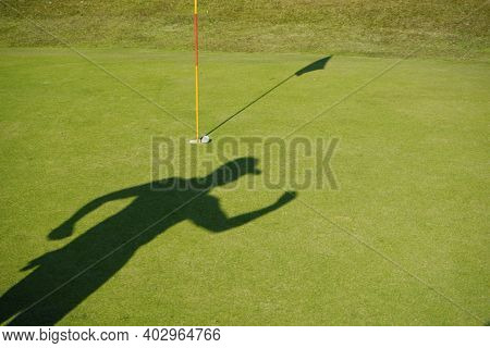 Blurred Shadow Of Golfer Playing Golf In Beautiful Golf Course In The Evening Golf Course With Sunsh