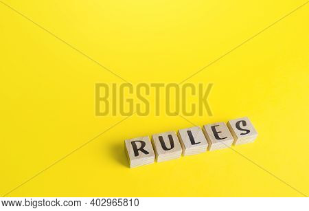 Blocks With The Word Rules On Yellow Background. Laws And Community Ethics Norms. Terms Of The Contr