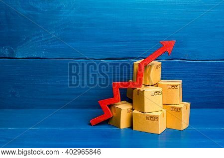Cardboard Boxes And Red Arrow Up. Transformation Of The Economy And Trade Into Online Marketplaces,