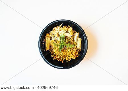 Wok rice cooked with soy sauce, vegetables and chicken pieces.