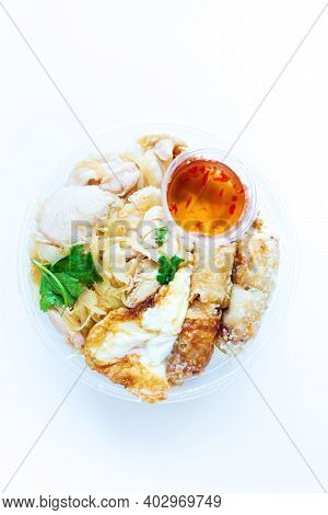 Delicious Vietnamese Bo Bun prepared with rice vermicelli noodles for basics and for topping chicken pieces and fried spring rolls